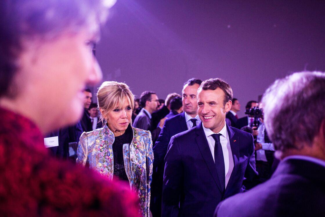 Emmanuel Macron, président de la République française et sa femme la Première Dame Brigitte Macron (Trogneux) - Dîner à l'occasion du One Planet Summit organisé par Bloomberg au Grand Plais à Paris, France, le 11 décembre 2017.