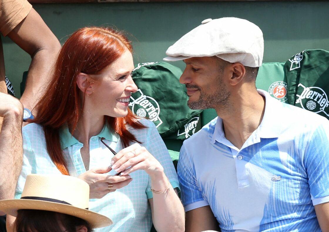 Audrey Fleurot et son compagnon Djibril Glissant, dans les tribunes de Roland Garros, à Paris, le 7 juin 2014.