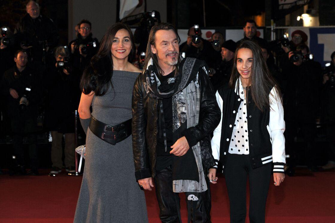 Florent Pagny et son épouse Azucena, aux côtés de leur fille Ael, à la 15e édition des NRJ Music Awards à Cannes, en 2013.