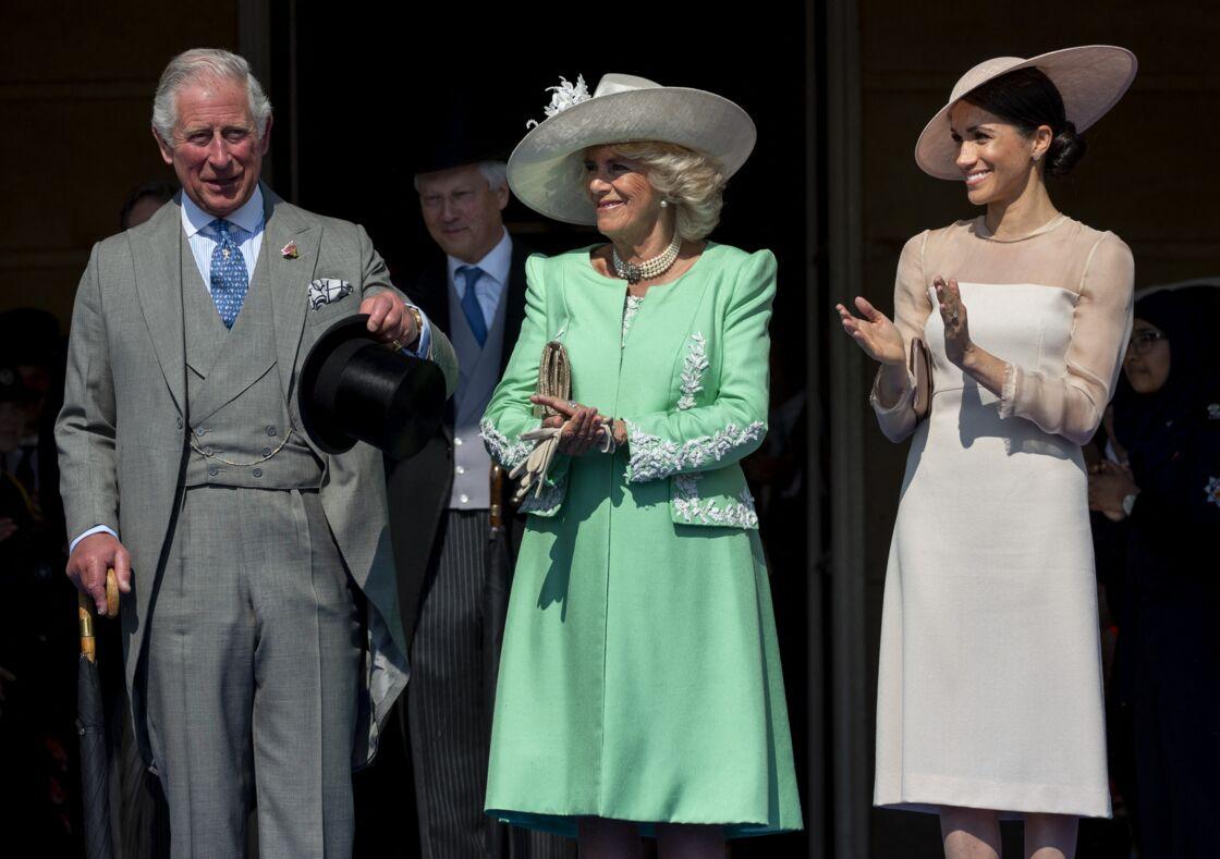 Le prince Charles, prince de Galles, Camilla Parker Bowles, duchesse de Cornouailles, Meghan Markle, duchesse de Sussex lors de la garden party pour les 70 ans du prince Charles au palais de Buckingham à Londres. Le 22 mai 2018