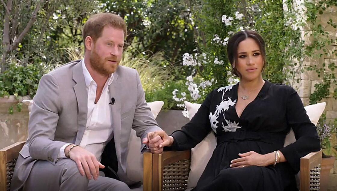 Le prince Harry, Meghan Markle, enceinte de son second enfant, face à la présentatrice américaine Oprah Winfrey, au cours d'une interview explosive diffusée en mars dernier.