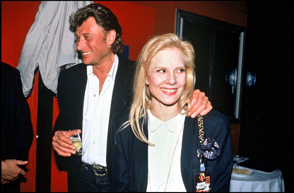 Johnny Hallyday et Sylvie Vartan, au concert de leur fils David le 11 mars 1991