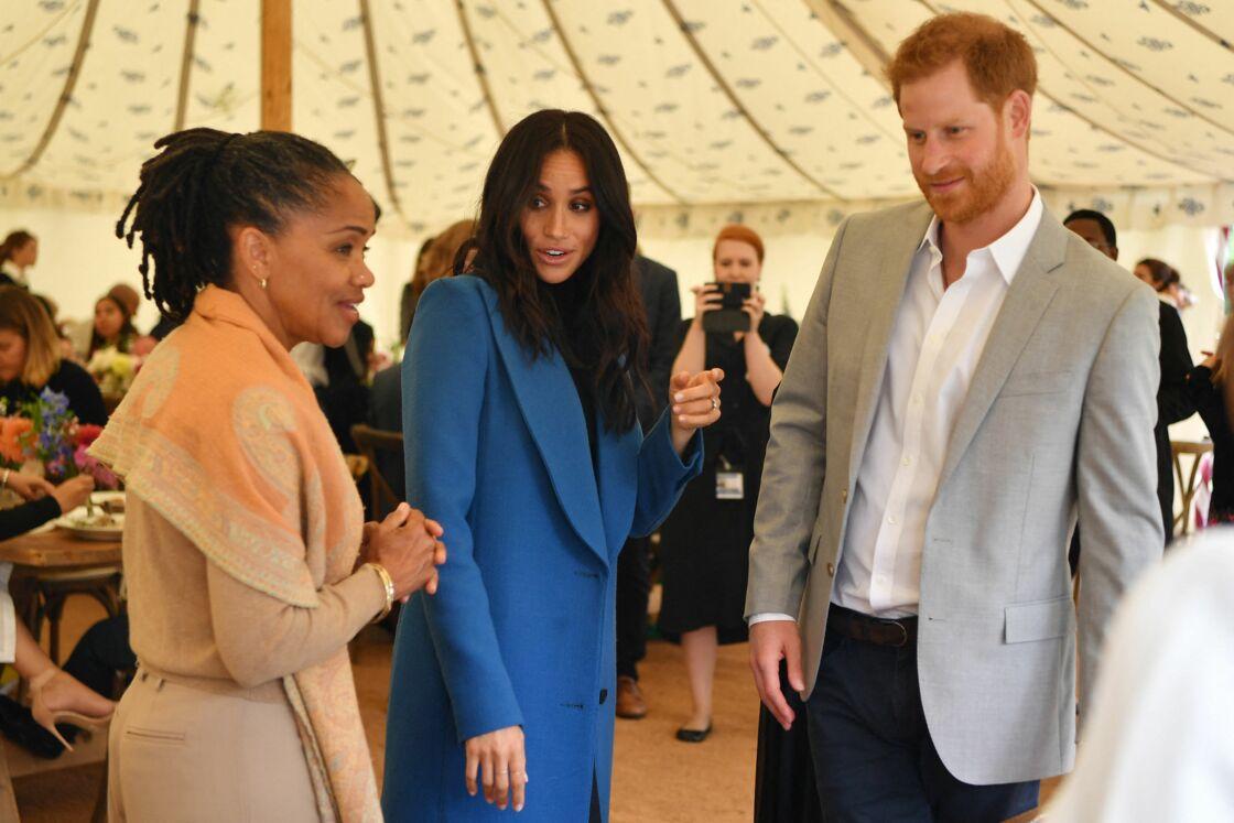 Meghan Markle, le prince Harry et Doria Ragland au palais Kensington, à Londres, en 2018.