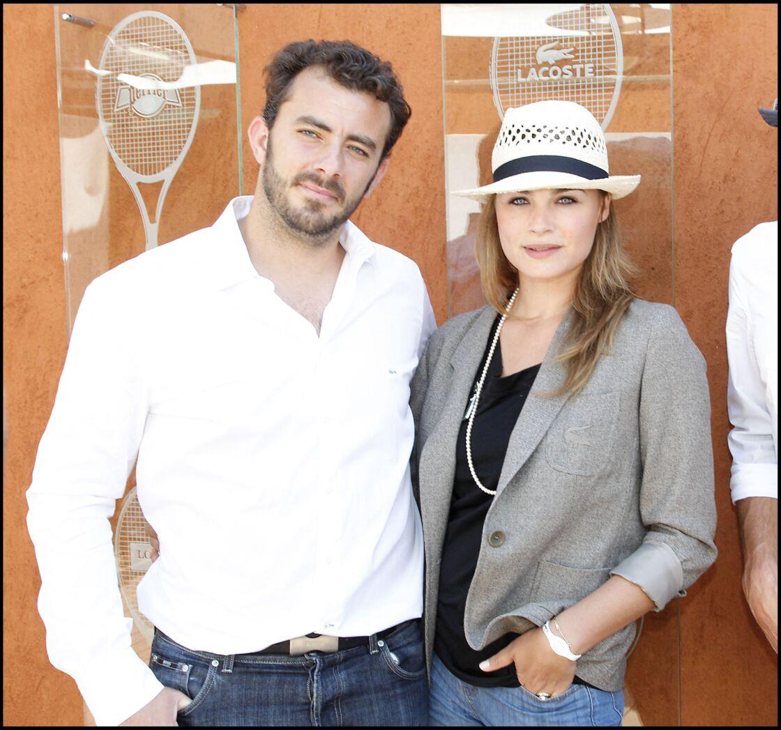 Mélanie Maudran et son mari Thierry Ascione assistent au tournoi de Roland Garros, le 28 mai 2010.