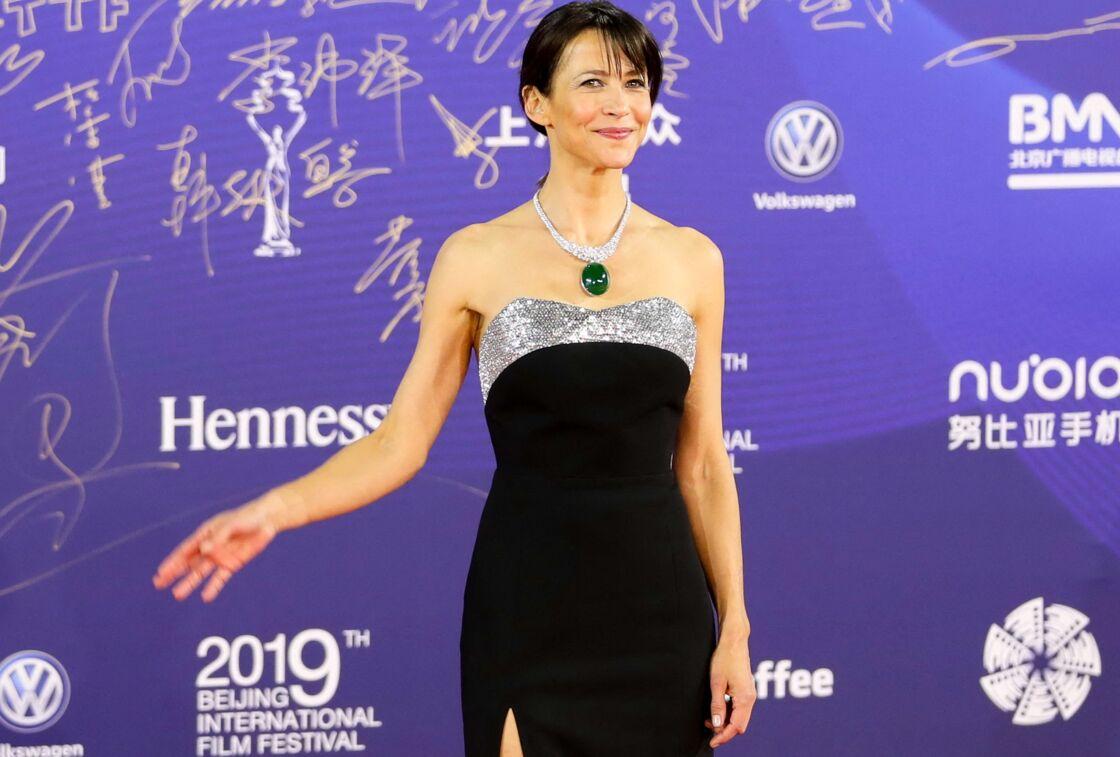 Sophie Marceau sur le tapis rouge de la cérémonie d'ouverture du 9ème festival international du film de Pékin, en Chine, le 13 avril 2019.