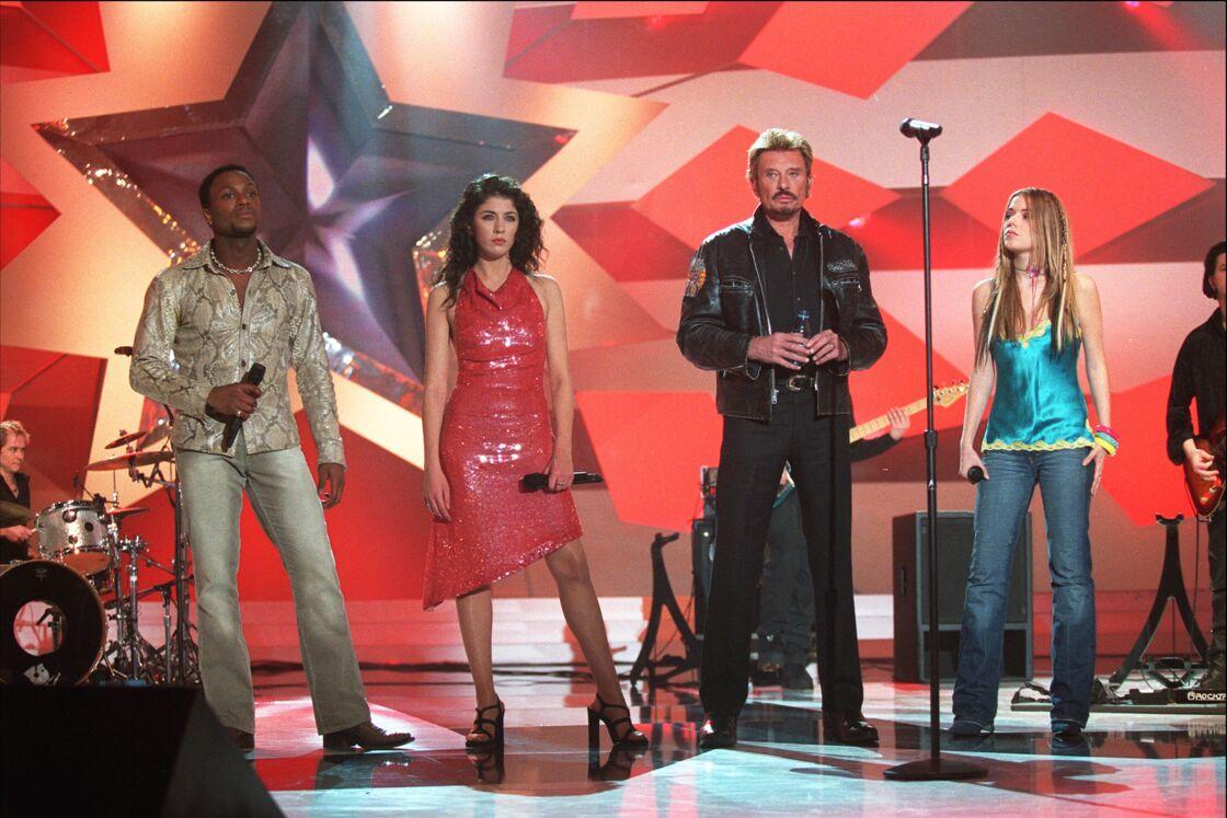 Houcine, Nolwenn Leroy, Johnny Hallyday et Emma Daumas sur le plateau de la 'Star Academy' le 15 décembre 2002