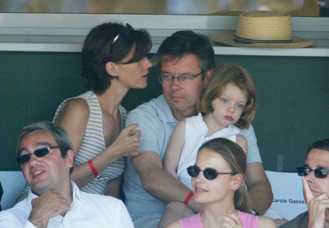 Carole Gaessler, son mari Franck, et leur fille Margaux, à Roland-Garros en 2003