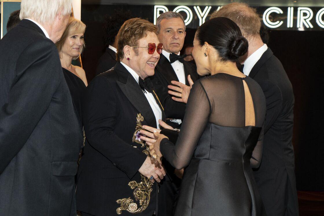 Le prince Harry et Meghan Markle avec Elton John et son mari David Furnish à la première du film