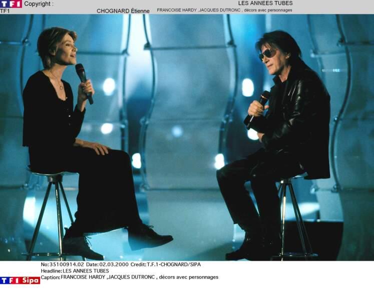 """Année 2000: les Dutronc-Hardy mènent déjà des vies séparées, mais chantent en duo """"Puisque vous partez en voyage""""."""