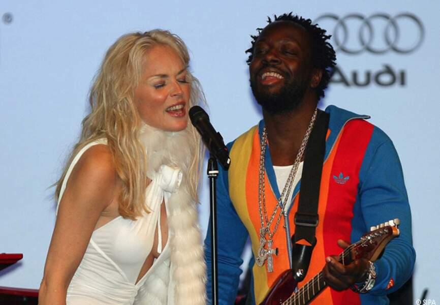 Sharon Stone et Wyclef Jean lors du gala de l'amfAR de 2006