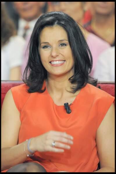 Faustine Bollaert opte pour la robe orangée le 14 octobre 2009