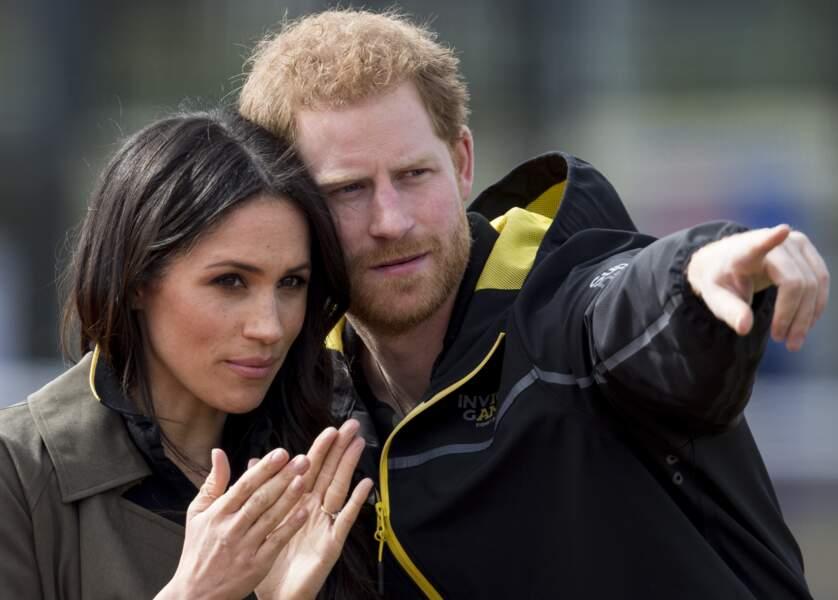 Le prince Harry en pleine explication de stratégie avec sa belle Meghan Markle