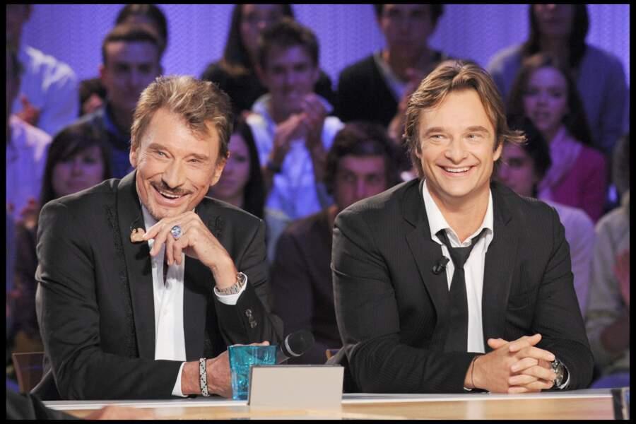 """Johnny et David Hallyday sur le plateau de l'émission """"Le Grand Journal"""" en 2008"""