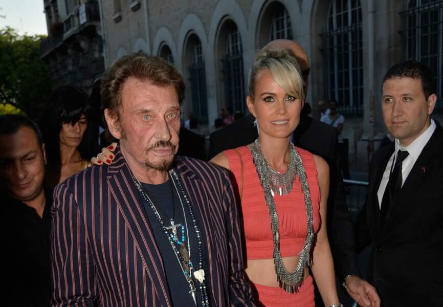Johnny et Laeticia Hallyday au défilé Saint Laurent à Paris