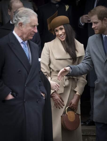 Le prince Charles, Meghan Markle et le prince Harry, à leur arrivée à l'église de Sandringham, le 25 décembre 2017