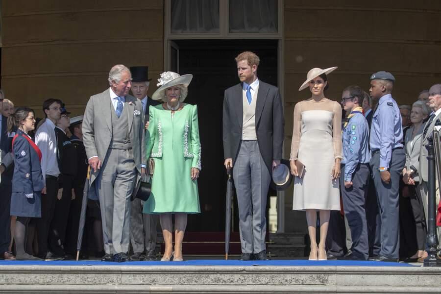 Charles, Camilla, Harry et Meghan lors de la garden party à Buckingham, le 22 mai 2018