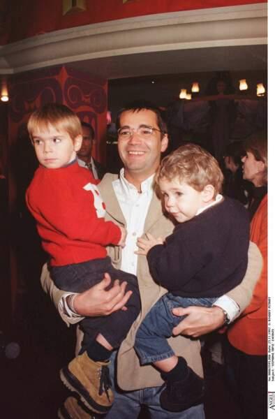 Stephane Tapie et ses enfants à une première du film l'Hercule au Grand Rex à Paris.