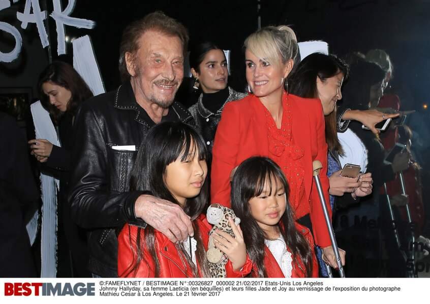 Johnny, Laeticia, Joy et Jade à l'exposition du photographe Mathieu Cesar le 21 février 2017 à Los Angeles