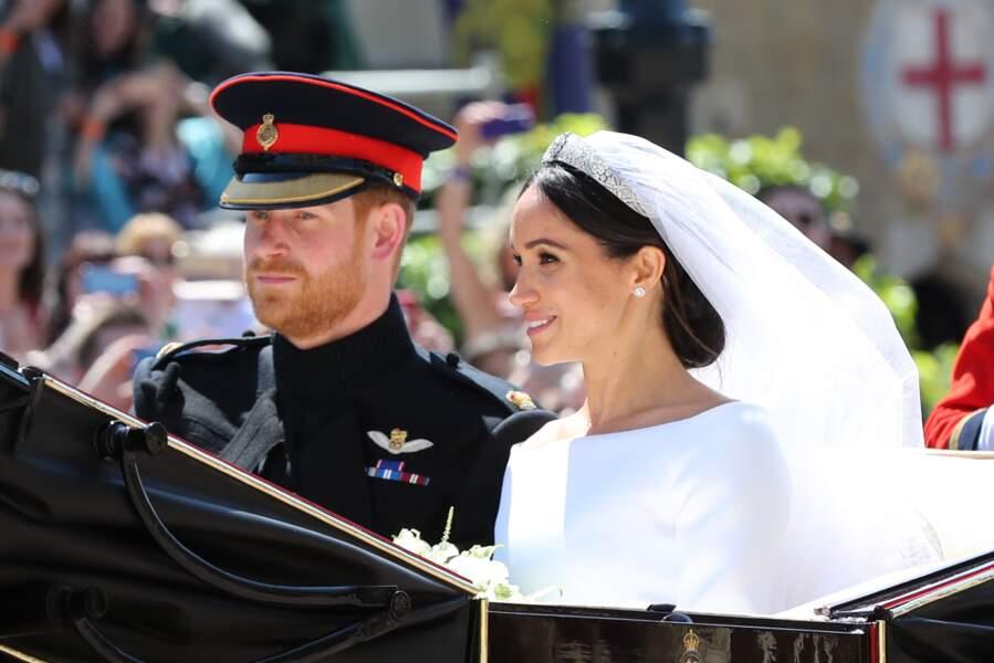 Harry et Meghan Markle en calèche à la sortie du château de Windsor après leur mariage le 19 mai 2018