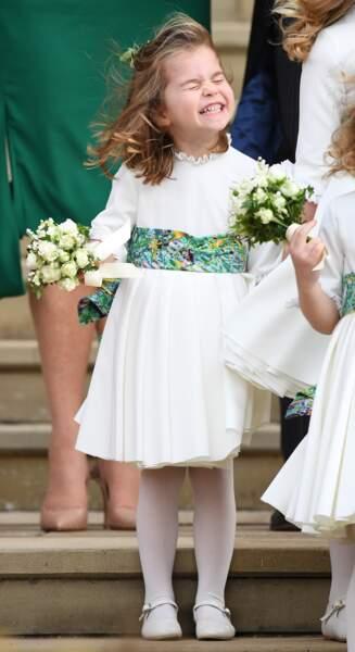 La princesse Charlotte faisant la grimace fièrement au mariage d'Eugenie d'York en octobre 2018
