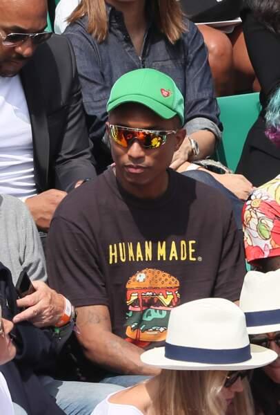 Pharrell Williams et sa femme Helen Lasichanh en tribunes