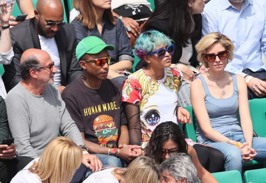 Pharrell Williams et sa femme très concentrés