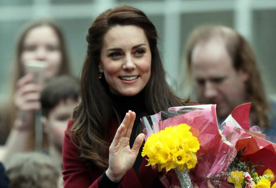 Kate Middleton rend visite aux les bénévoles et membres d'un centre pour enfants et adolescents déficients mentaux