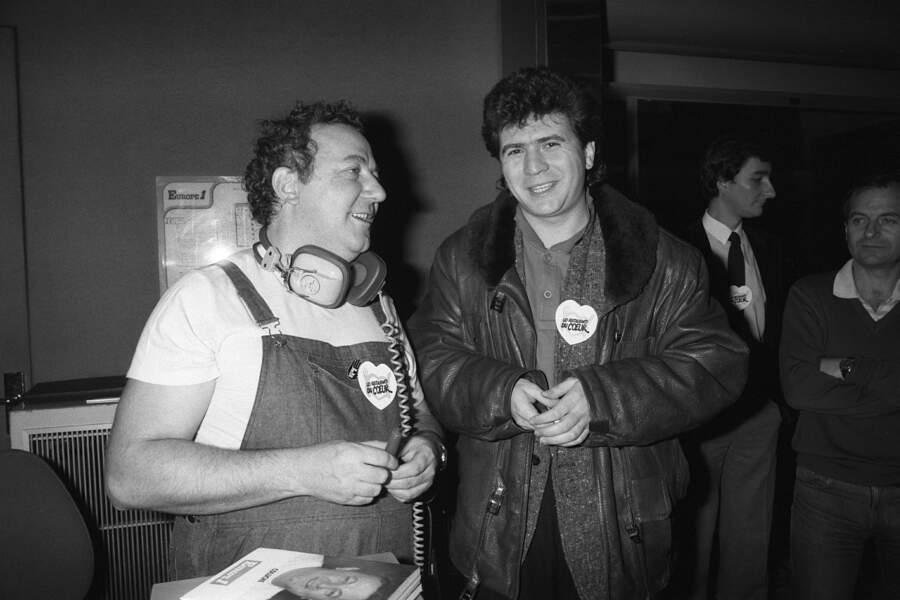 Coluche et son grand ami Daniel Balavoine en décembre 1985