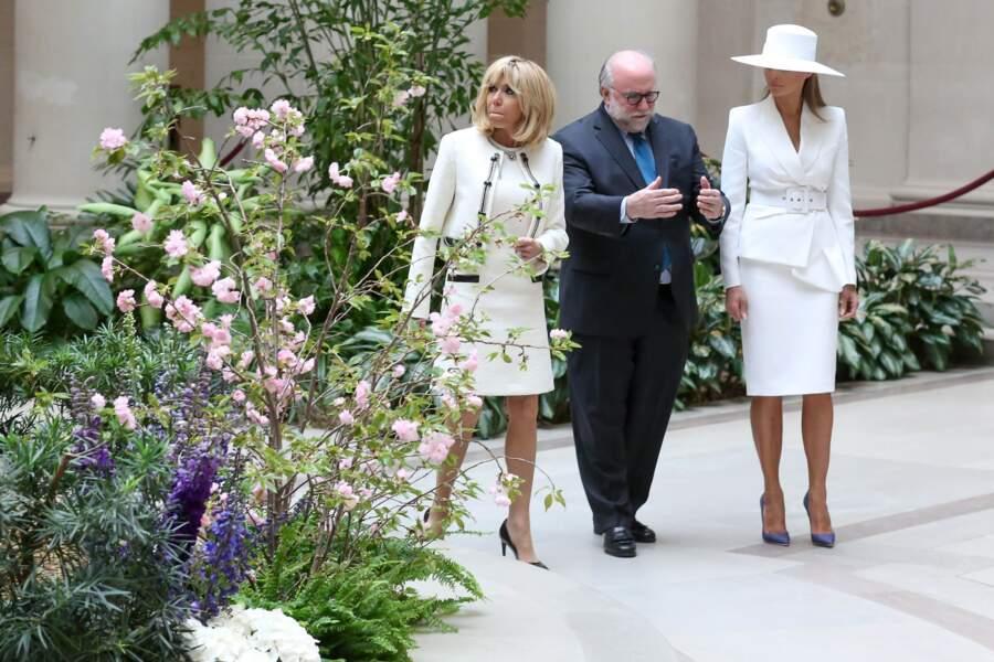 Brigitte Macron en tailleur blanc signé Louis Vuitton et Melania Trump en Michael Kors