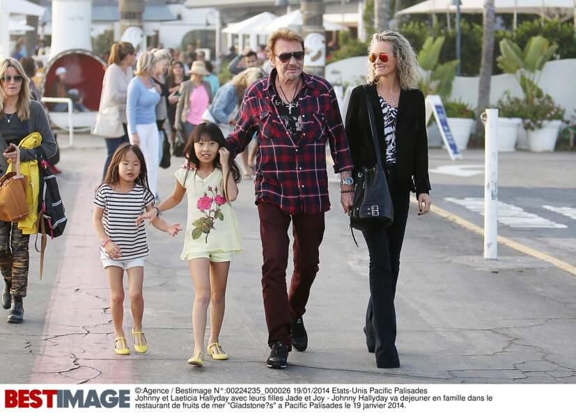 En janvier 2014, Joy, Jade, Johnny et Laeticia Hallyday lors d'un déjeuner à Pacific Palisades