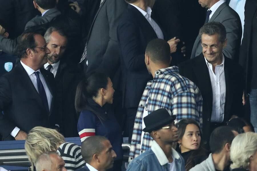 François Hollande et Nicolas Sarkozy avec Kourtney Kardashian devant eux