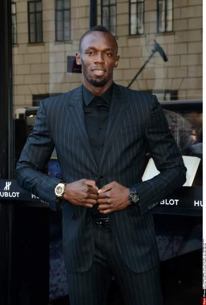 Costume sombre à la ville pour Usain Bolt, quel homme!
