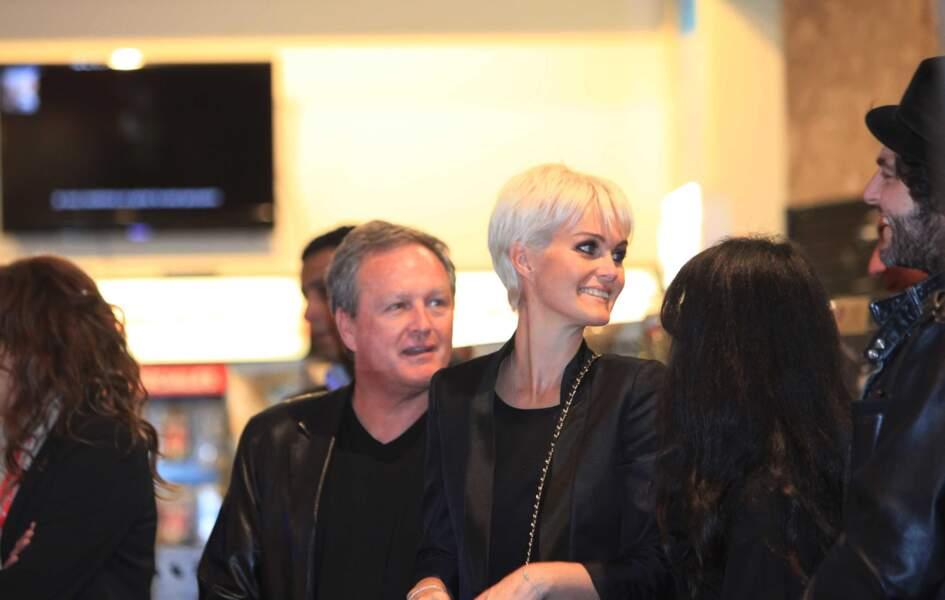 """André Boudou et sa fille Laeticia Hallyday lors de la sortie de l'album """"Jamais seul""""."""