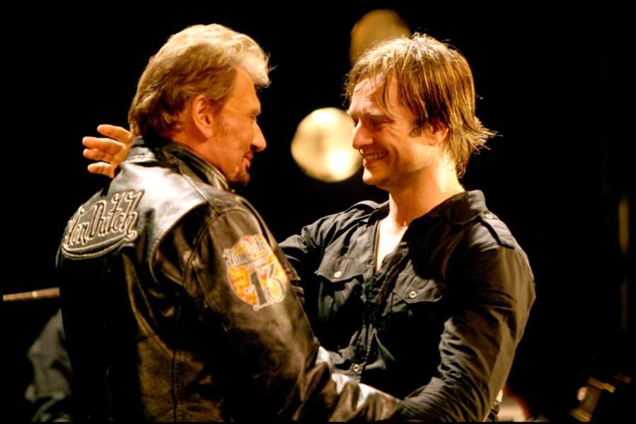 Johnny et David Hallyday sur scène à la Cigale à Paris en 2008