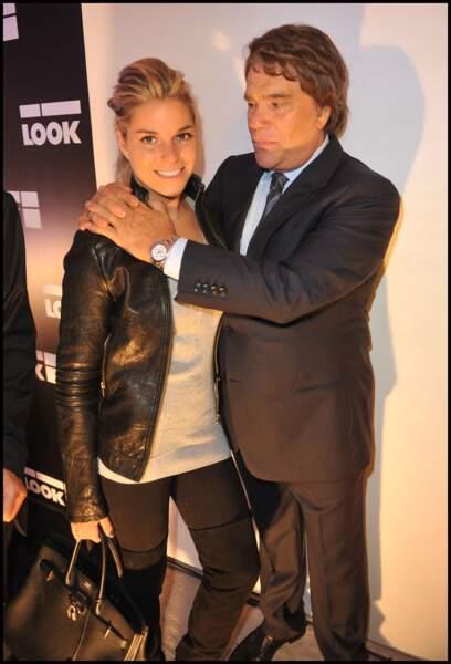 Bernard Tapie et Sophie, sa dernière fille à l'inauguration de la boutique LOOK à Paris, le 17 octobre 2011.