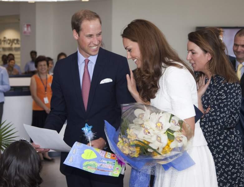 William et Kate, souriant, lors de leur visite à Singapour, le 12 septembre 2012
