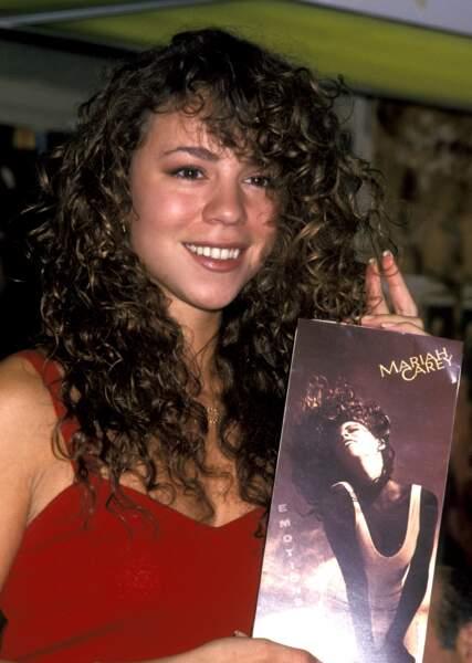 1991, sourcils épais et tignasse folle ce n'est pas encore la Mariah que l'on connaît
