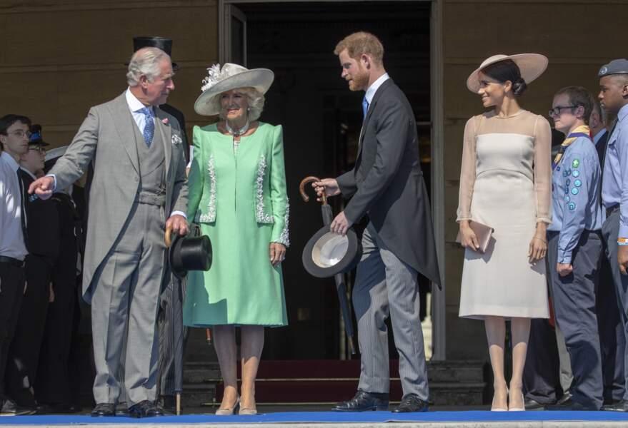 Camilla, Harry et Meghan lors de la garden party pour les 70 ans du prince Charles, le 22 mai 2018
