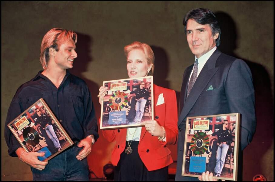David Hallyday, Sylvie Vartan et Tony Scotti lors d'une soirée au Palace à Paris en 1989