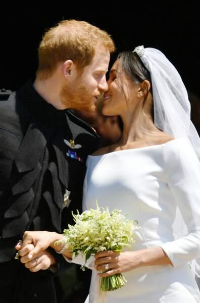 Meghan Markle et le prince Harry lors de la sortie après la cérémonie de mariage, le 19 mai 2018.