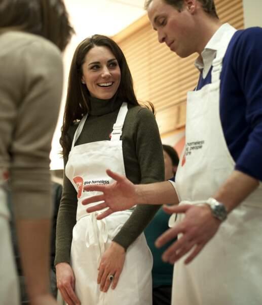 Kate et William lors d'une visite d'un foyer de sans logis à Londres, le 21 décembre 2011