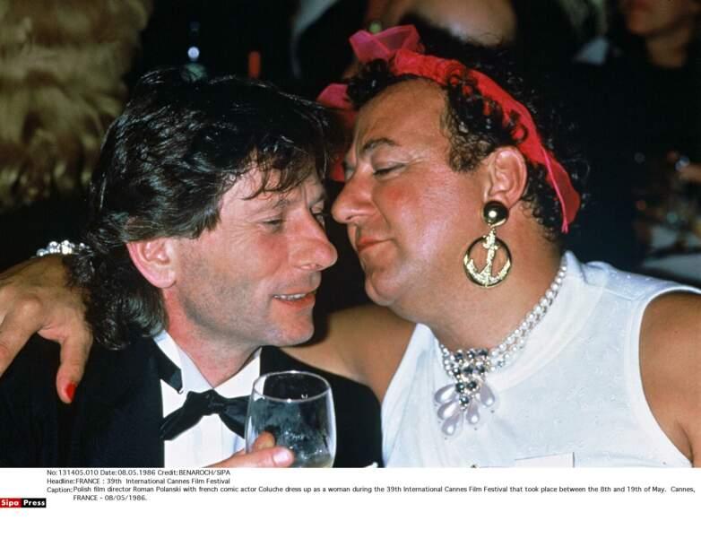 Coluche et Roman Polanski lors de la 39e édition du festival de Cannes
