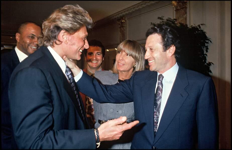 Johnny Hallyday, Dany Saval et Michel Drucker à l'anniversaire de Jean-Paul Belmondo en 1993