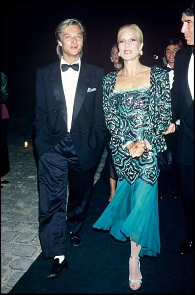 """David Hallyday et Sylvie Vartan lors de la soirée de lancement du parfum """"Poison"""" de Christian Dior en 1985"""