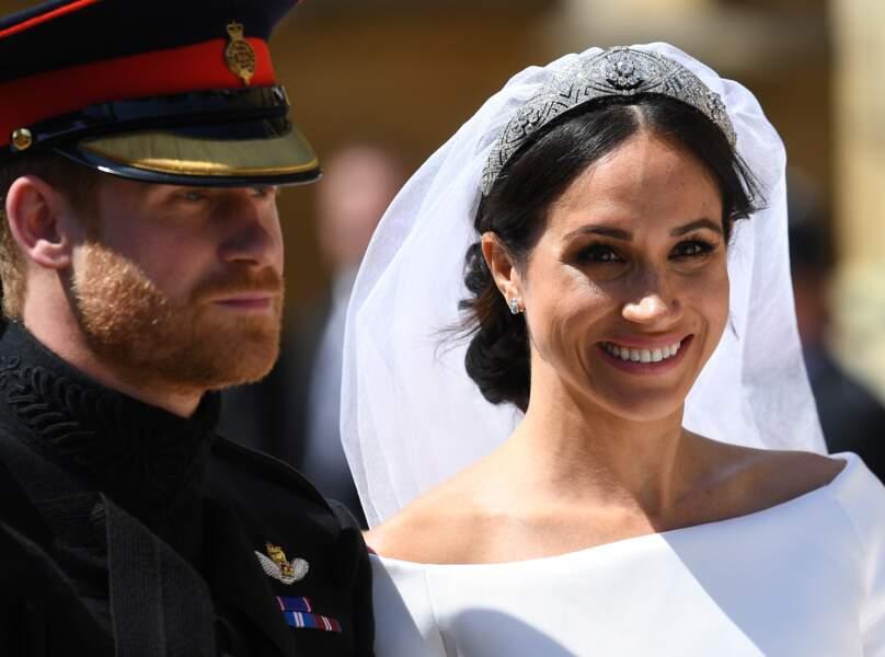 Le prince Harry, duc de Sussex, et Meghan Markle, duchesse de Sussex, en calèche à la sortie du château de Windsor