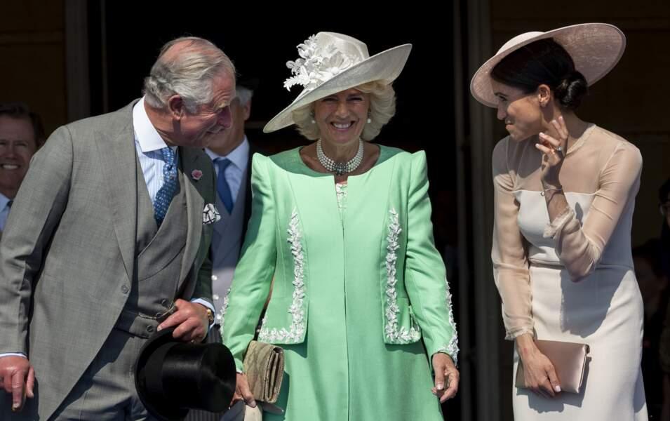 Charles, Camilla et Meghan ont affiché leur proximité lors de la garden party à Buckingham, le 22 mai 2018