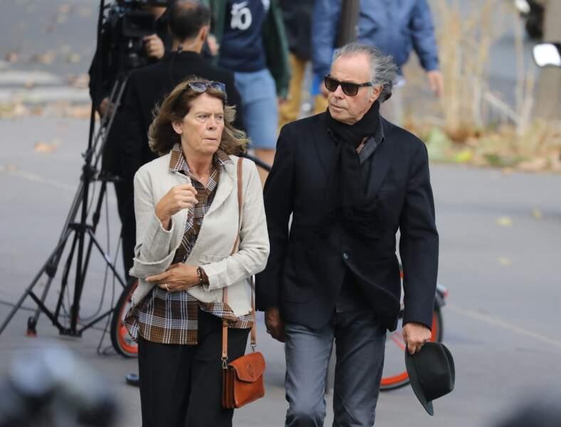 Michel Leeb, sa femme Béatrice aux obsèques ducomédien Jean Piat en l'église Saint François-Xavier à Paris le 21 s