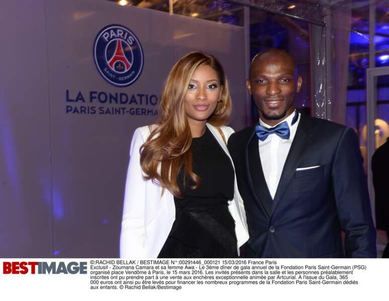 Zoumara Camara (en Hugo Boss) et sa femme Awa
