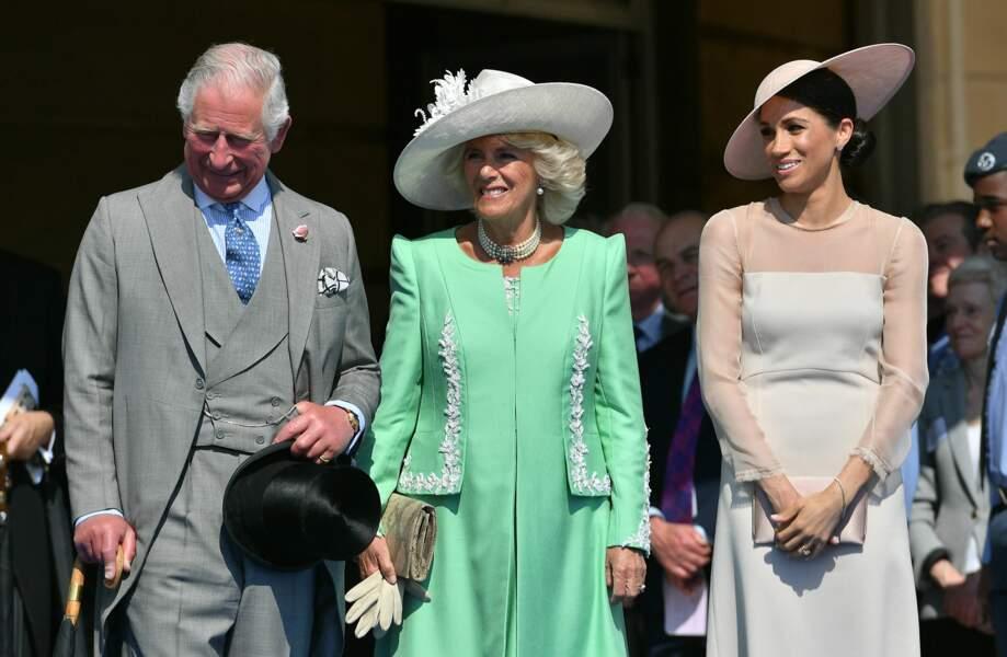 Meghan avec Camilla lors de la garden party des 70 ans du prince Charles à Buckingham, le 22 mai 2018