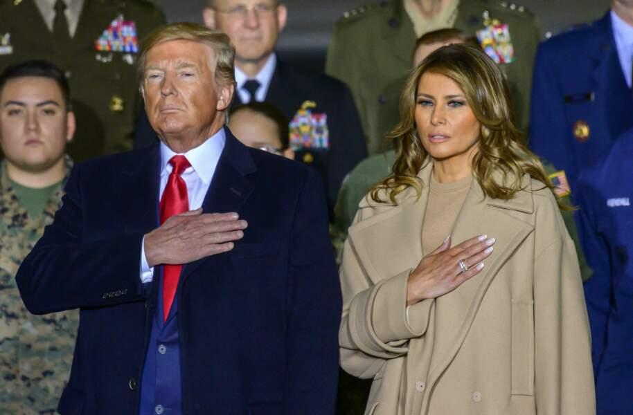 Melania et Donald Trump pendant l'hymne national américain dans le Maryand, le 20 décembre 2019